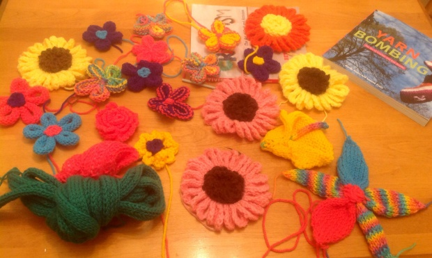 The elements of the D'vine project before it was assembled and installed.  A yarn bomb with knitted and crocheted flowers that was installed on the post in front of Twillingate Post Office