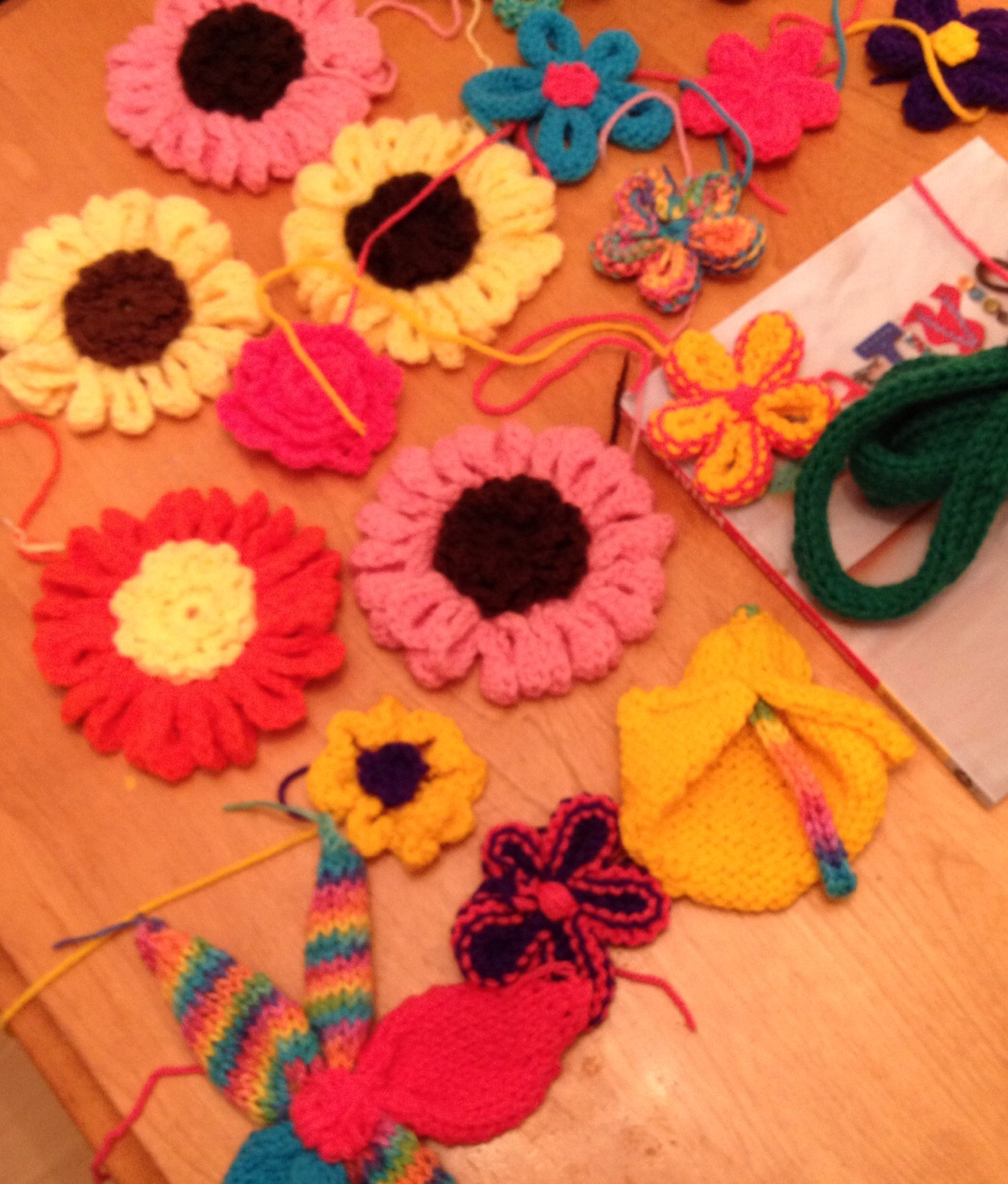 Parts of what will finally become D'vine, a knitted yarn bomb vine with knitted and crocheted flowers attached.